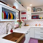 pedestal sink with backsplash drawers wooden floors utensils faucets decorative plates bottles microwaves eclectic style