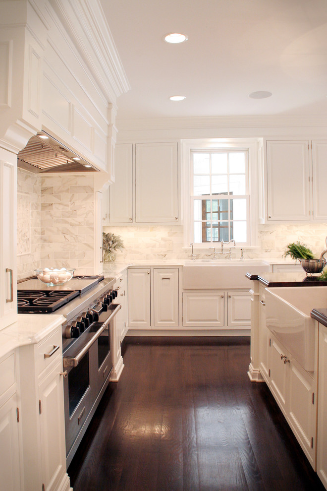 pedestal sink with backsplash hardwood floor stove cabinet ceiling lamps countertop traditional style