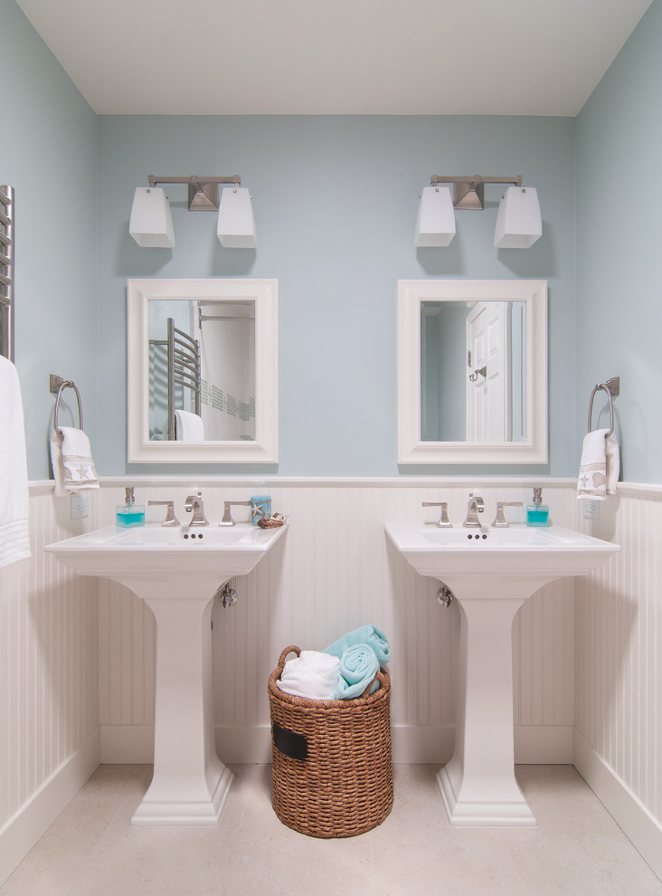pedestal sink with backsplash mirrors basket faucets towel rack wall lamps traditional design