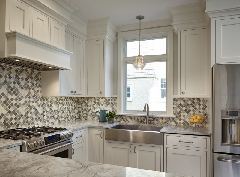 pedestal sink with backsplash stove hanging lamp fridge marble countertop wall cabinets drawers storage transitional style