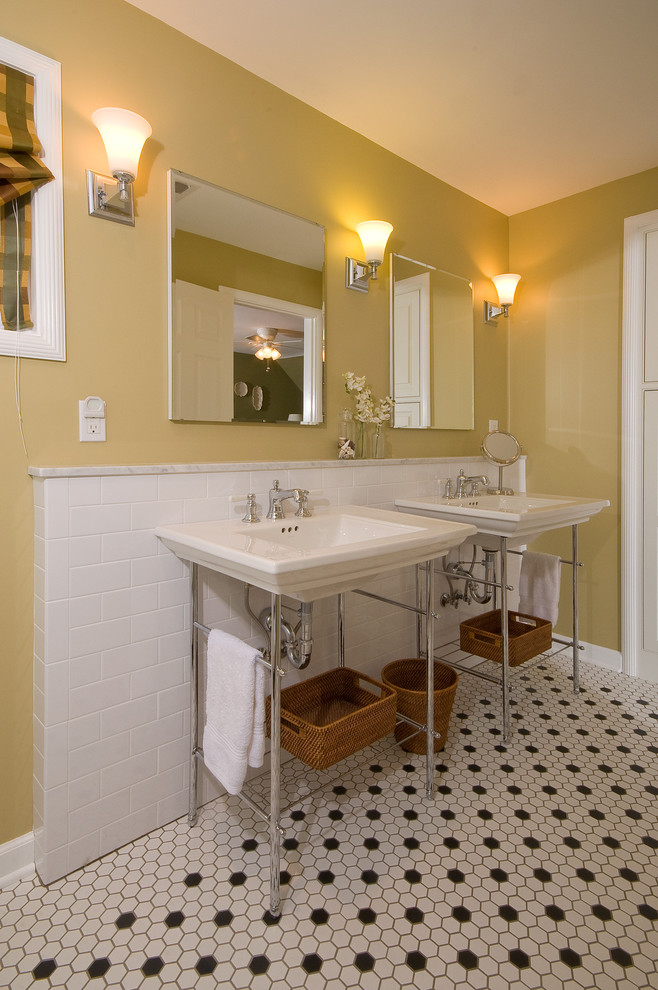 pedestal sink with backsplash tiles baskets storage wall lamps window blind traditional style