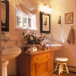 pedestal sink with backsplash wooden floor wood cabinets towel rack wall decoration faucet traditional style