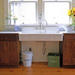 pedestal sink with backsplash wooden floor wood cabinets vase windows faucet countertop stove traditional design