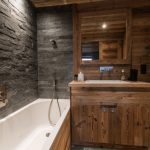Rustic Bathroom Towel Warmer Walk In Shower Tub Combo Wood Cabinet Stone Wall Traditional Mirror
