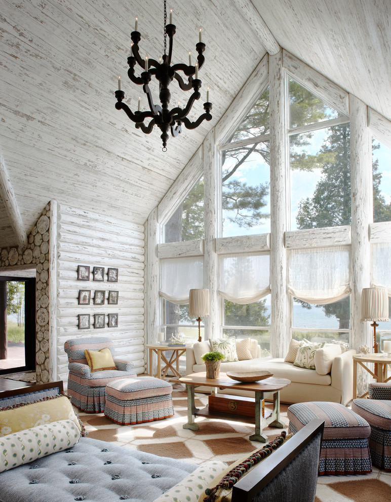 rustic living room small a frame cabin plans white cabin monochrome rug soft color patterned chair and footstools white couch white window blind