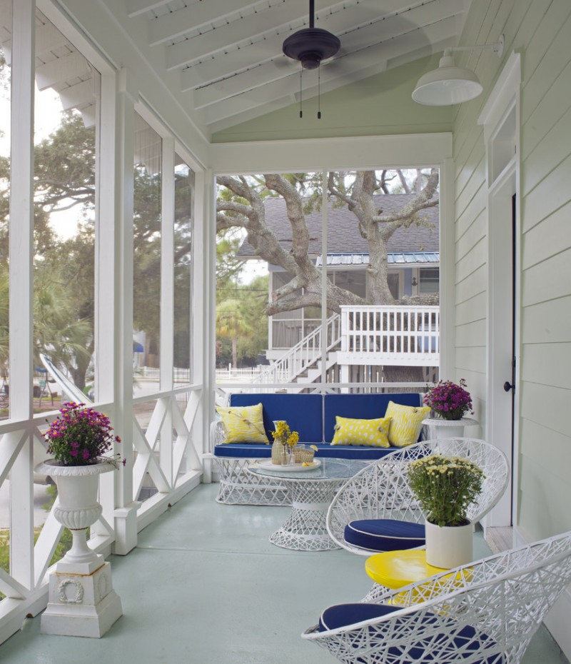 screen porch designs concrete slab decking roof extension bench chairs small table stairs white railing urn ceiling fan light fixture beach style