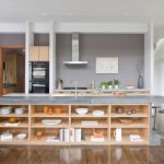 Simple Contemporary Kitchen Idea With Concrete Top Kitchen Island With Wood Open Shelves Black Finished Appliances Wood Storage Idea Clear And Gloss Wood Floors