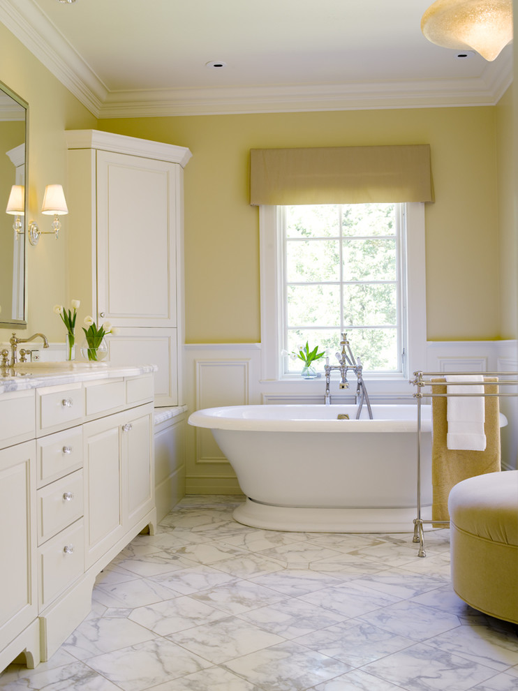 soft butter yellow wall painting idea with white wall trims white bathroom fixtures white bathroom vanity light grey flooring idea buttery yellow bean bag chair