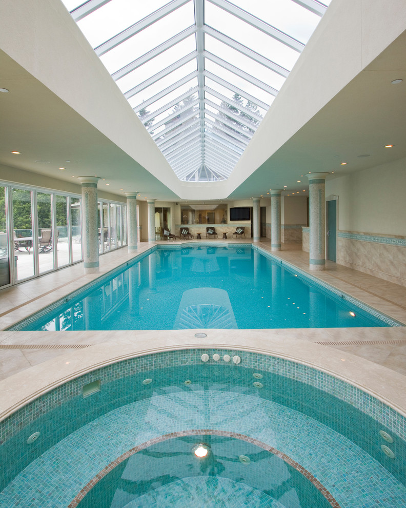 square interior pool with sliding glass enclosure round shaped spa pool light beige floors