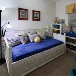 storage bed shelves drawers lovely pillows paintings lamps carpet contemporary kids room