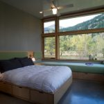 storage bed small table drawers lamps very long bench big windows ceiling fan pillows contemporary style bedroom