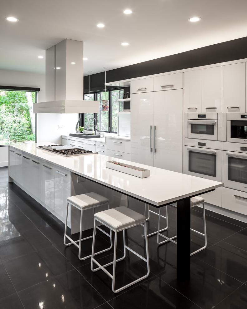 stove on white glossy island under alumunium cooker hood