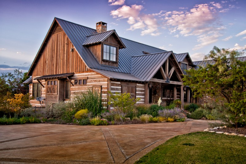 texas ranch house plans gable roof wood exterior stone pavers surrounding garden light fixtures rustic design