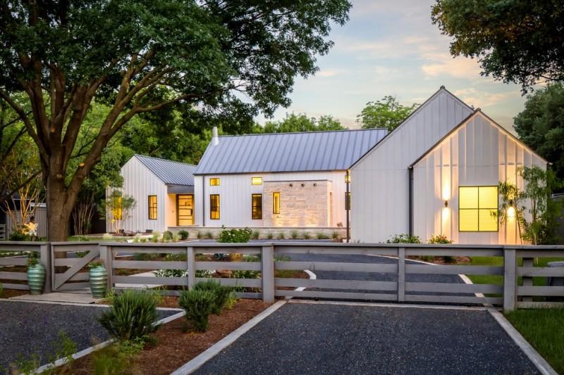 texas ranch house plans white exterior light fixtures gable roof column windows concrete pavers wood fence urns garden farmhouse design