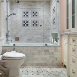 Traditional Bathroom Design With Marble Walls And Floors Two Piece Toilet Shower Space With Bathtub And Glass Door Panel Walk In Closet In Pastel