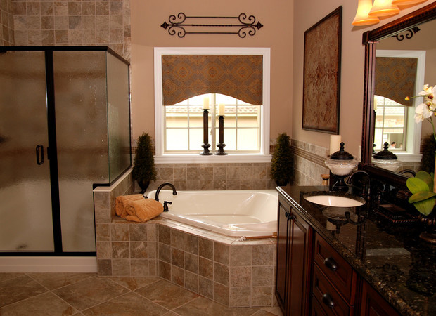 traditional bathroom with corner tub light beige painted concrete walls beige tiles walls beige ceramic floors dark wood finished cabinet