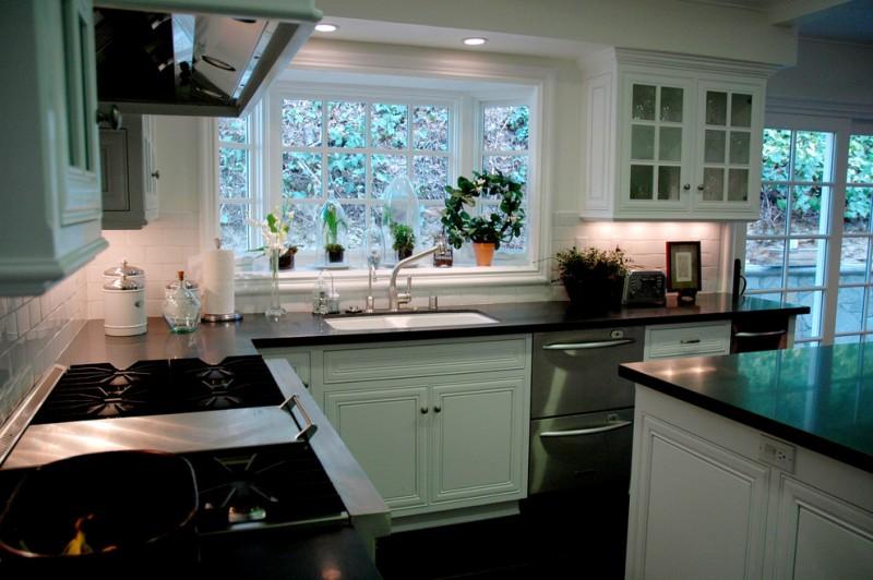 Traditional Kitchen Greenhouse Window Dishwasher Black Marble Countertop White Minimalist Cabinet