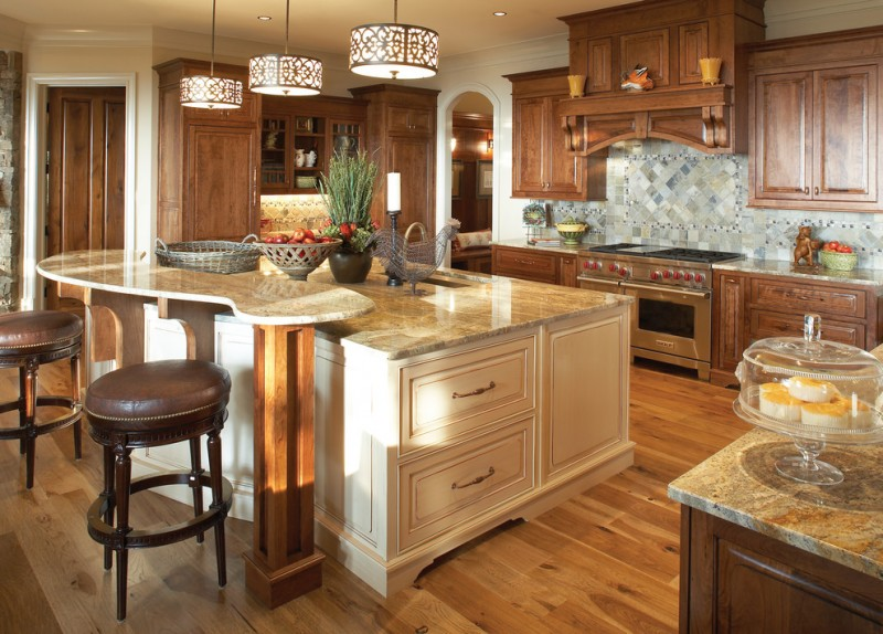 traditional kitchen idea with wood cabinets stainless steel appliances multicolored tiles backsplash white kitchen island with elevated surface addition medium toned wood floors