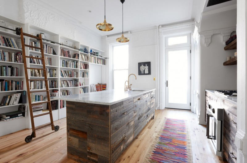 transitional kitchen idea with rustic kitchen island floor to ceiling white bookshelf with reading nook and ladder medium toned wood floors