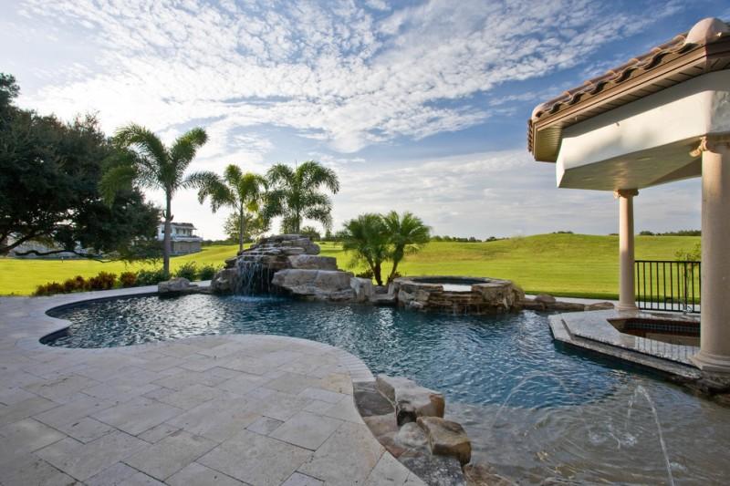 travertine pavers pool deck pillars jacuzzi fountains steel fence trees decorative plants mediterranean design