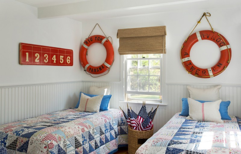 twin bedrooms american flags orange buoys over beds numbers wall artworks framed glass window brown window shade white wall