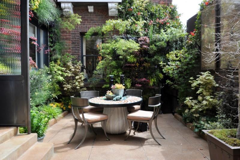 vertical garden plans round table chairs plant pots steps brick walls beige pavers contemporary design