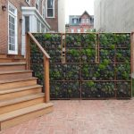vertical garden plans wood stairs railing brick pavers walls white windows doors planters contemporary design