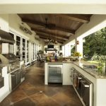viking outdoor kitchen marble countertop stainless steel appliances ceramic tiles stove chairs table ceiling fan lights mediterranean style