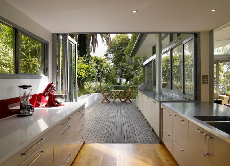 viking outdoor kitchen wooden floor deck countertop cabinetry sink glass door chairs table contemporary design