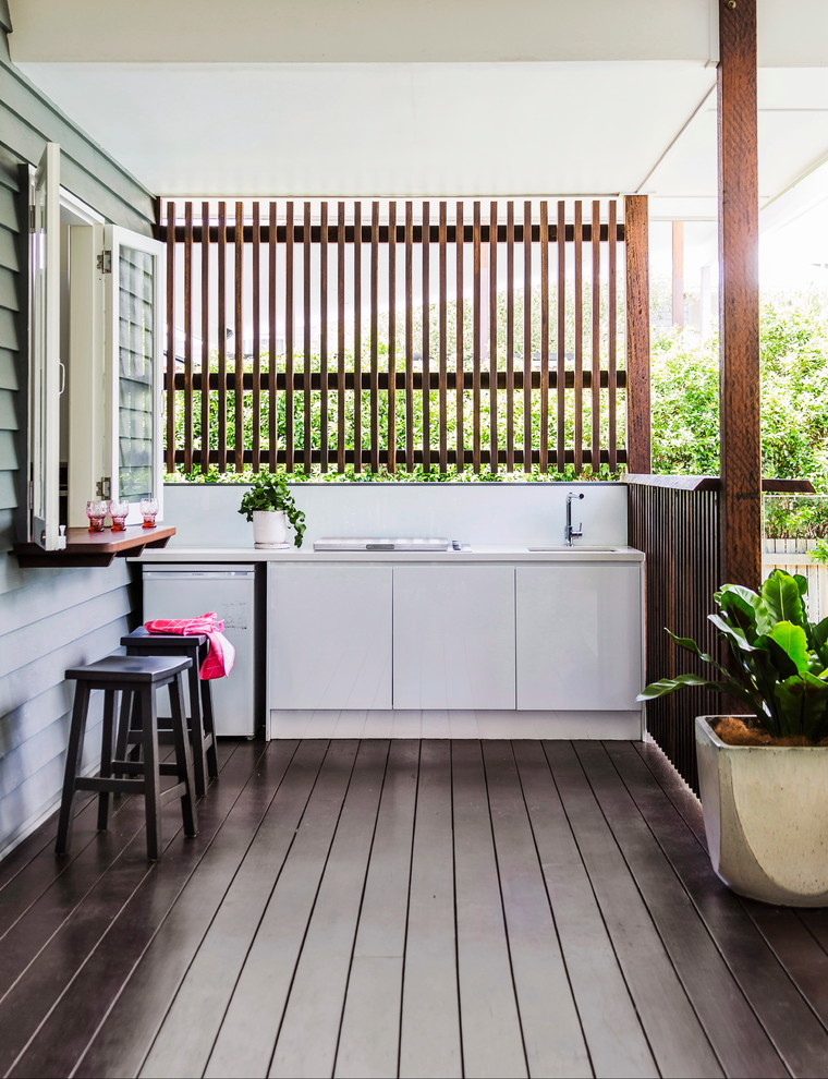 viking outdoor kitchen wooden floor stools white cabinets faucets sink fence plant pot windows contemporary style