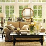 Walnut Pottery Barn Sofa Dark Painted Coffee Table Pillow Throws Candles Table Lamp Rattan Rug Medium Toned Wooden Floor