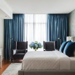 ways to hang curtains blue white curtain floral patterns carpet bed pillows bedside tables chairs drawers flowers lamp transitional bedroom