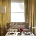 ways to hung a curtain chairs low table couch pillows flowers lamp chandelier transitional living room