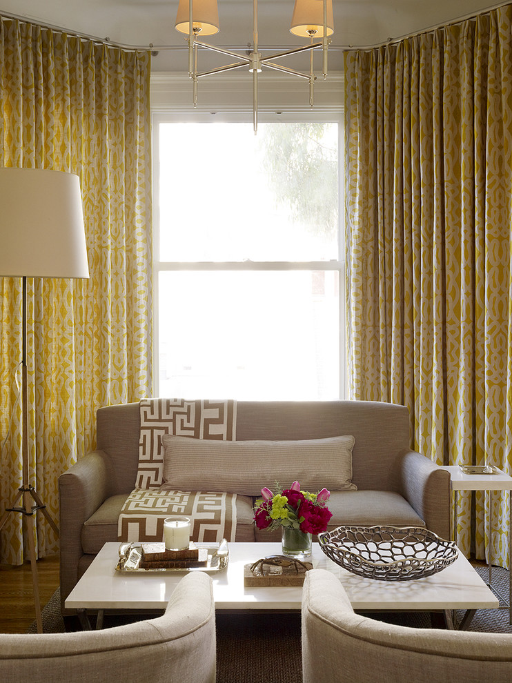 ways to hang curtains chairs low table couch pillows flowers lamp chandelier transitional living room
