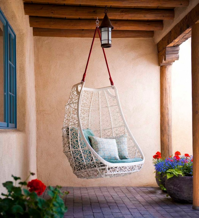 white egg swing for small porch blue couch white patterned pillow red rop