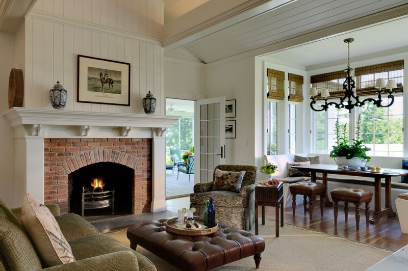 white walls a standard fireplace a brick fireplace brown sofa leather sofa table cream rug medium toned wooden floors