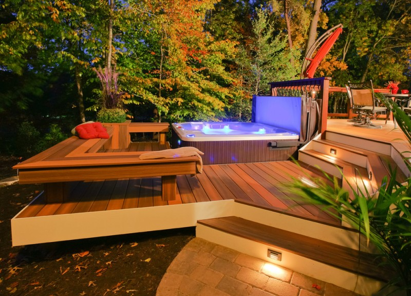 wooden lpe deck with built in bench, darker wooden hot tub with retractable cover