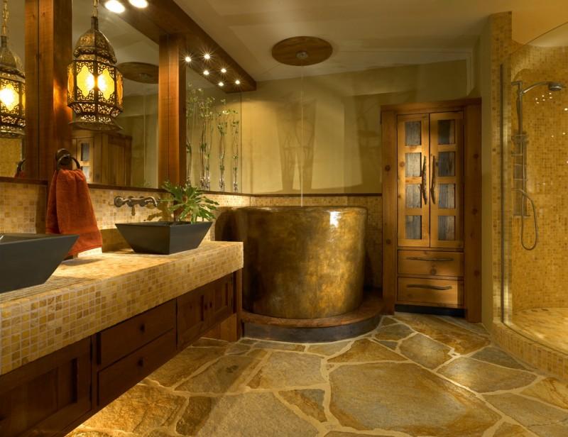 Concrete Japanese soaking tub stone pavers floors bathroom cabinet tiles countertop wood frame around mirror glass door shower room