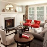 Elegant Living Room With Grey Walls Red Club Chairs White Chairs Grey Sofa Candle Hholders Coffee Table White Painted Cabinets A Fireplace Glass Windows Medium Toned Wooden Floors