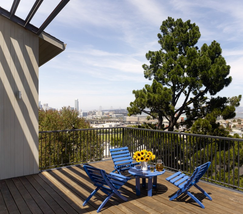 IKEA blue chair sets round table a vase of sunflowers wooden deck balcony floor