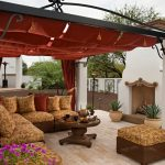 Mediterranean Patio With Red Fabric Ceiling And Red Drapes