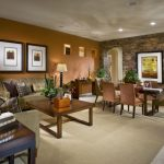Mid Sized Trendy Formal Open Concept Living Room With Orange Walls And Ceramic Floors Brown Soffa Wooden Coffee Table And Cabinet Cream Carpet