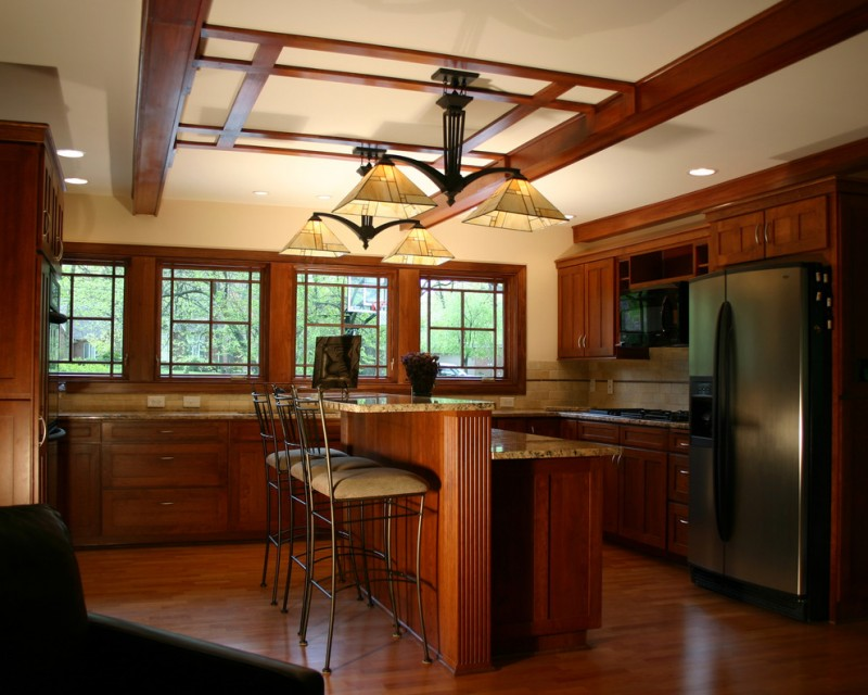 Mission Style kitchen design dark toned cabinets dark toned kitchen island with marble countertop stainless steel appliances dark hardwood floors