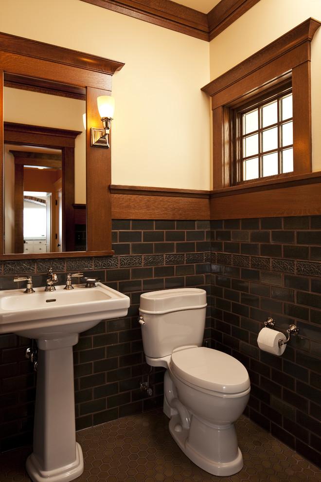 Mission Style powder room with white pedestal sink white toilet black subway ceramic tiles dark wood trims for window wood framed mirror light beige walls