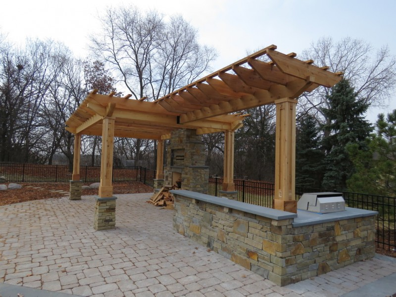 T shaped pergola made of cedar brick pavers floors natural stone paving fire feature