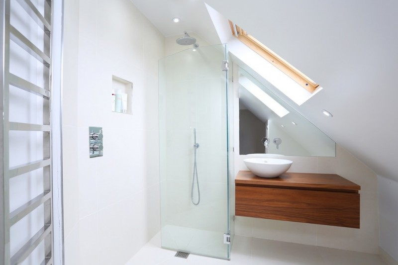 Trendy corner shower with a vessel sink, flat panel cabinets, medium tone wood cabinets, wood countertops and white walls chrome frame recessed shelf