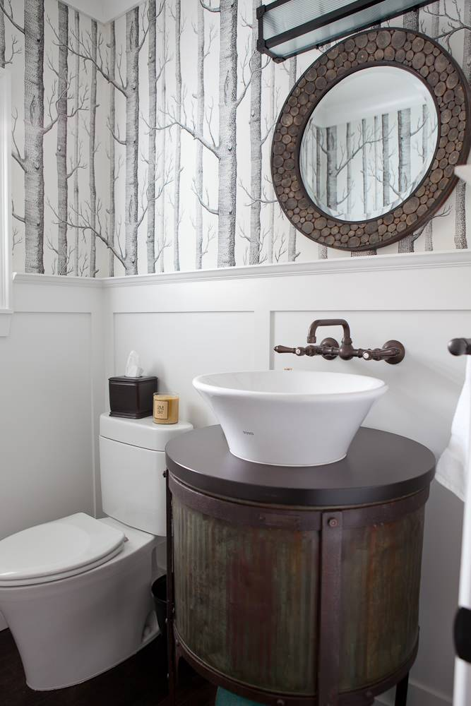 accent wall white wainscoting round antique mirror white sink vintage vanity wall mounted faucet