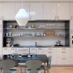 all in one kitchen unit cabinets oven shelves faucet sink table chairs stove contemporary style room