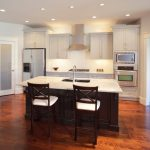 all in one kitchen unit chairs island faucet sink stove cabinets ceiling lights fridge oven contemporary style room