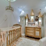 baby girl bedroom themes crib net cabinet chair lamp hardwood floor carpet beige walls traditional design